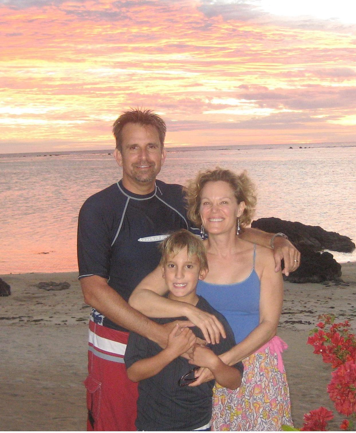 Mike Austin with his wife and son in the Cook Islands